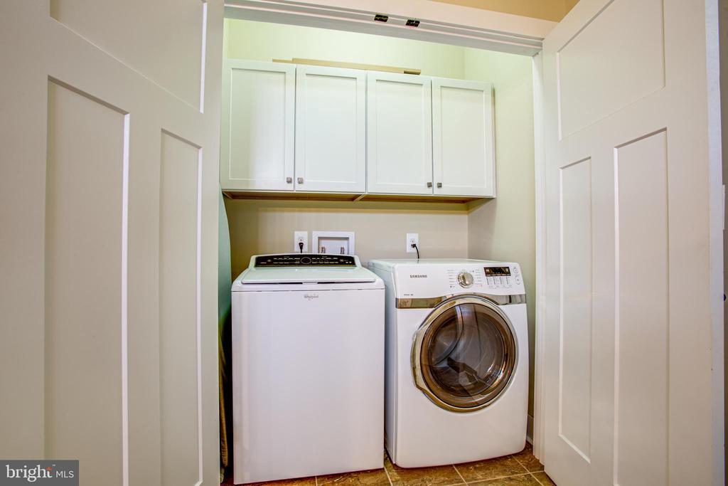 Cabinet storage in laundry area - 208 LIMESTONE LN, LOCUST GROVE