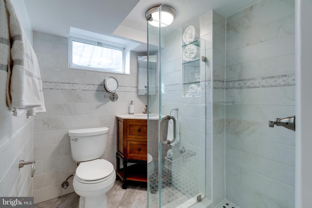 Renovated full bath in the basement - 604 N LATHAM ST, ALEXANDRIA