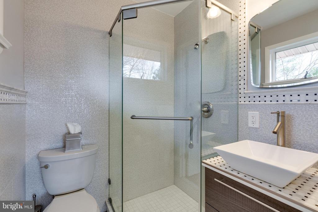 Owner's renovated bath with custom tile - 604 N LATHAM ST, ALEXANDRIA