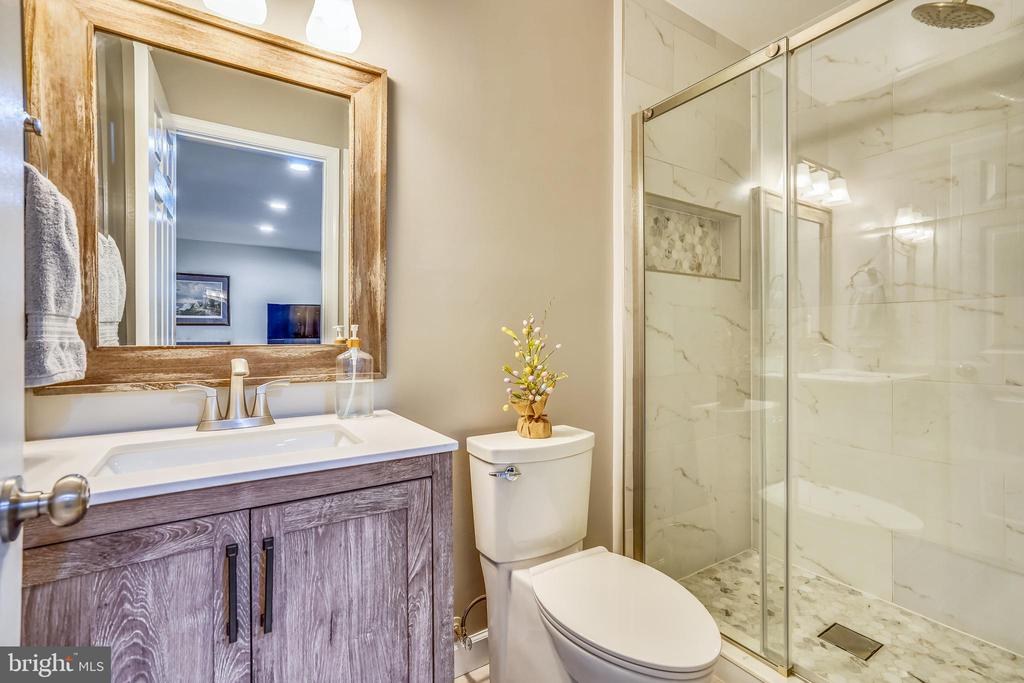 Full 3rd bathroom on lower level. - 4124 TROWBRIDGE ST, FAIRFAX