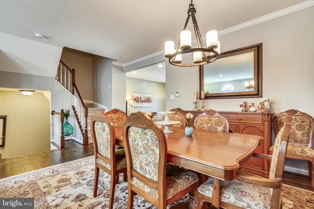 Large dining room with upgraded lighting. - 4124 TROWBRIDGE ST, FAIRFAX