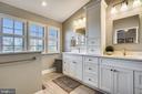 Custom cabinets and dual sinks lovely hardware. - 4124 TROWBRIDGE ST, FAIRFAX