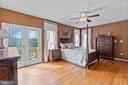 Primary Bedroom with French Doors to deck - 39 BETHANY WAY, FREDERICKSBURG