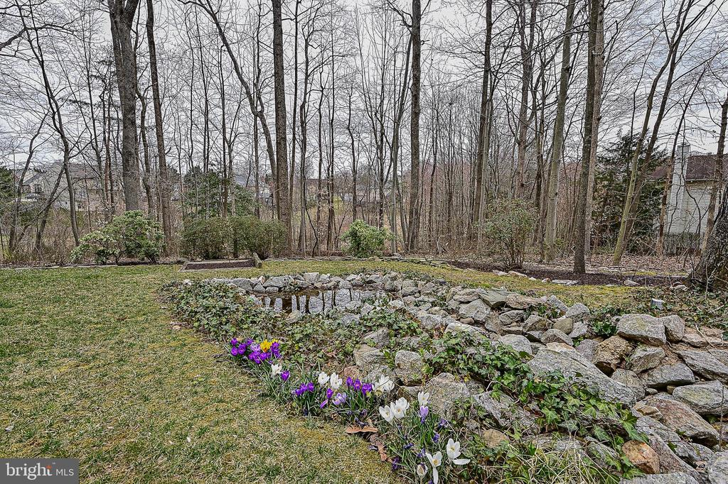 Lovely pond on side of home - 7839 VALLEYFIELD DR, SPRINGFIELD