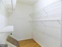 Master bedroom walk-in closet - 123 GRETNA GREEN CT, ALEXANDRIA