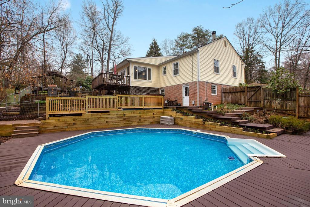 in ground pool with decking - 10613 PINEVIEW RD, MANASSAS
