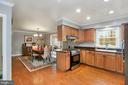 Kitchen with hardwood floors - 10613 PINEVIEW RD, MANASSAS