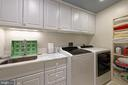 A cheerful laundry room with great storage space - 711 PRINCE ST, ALEXANDRIA