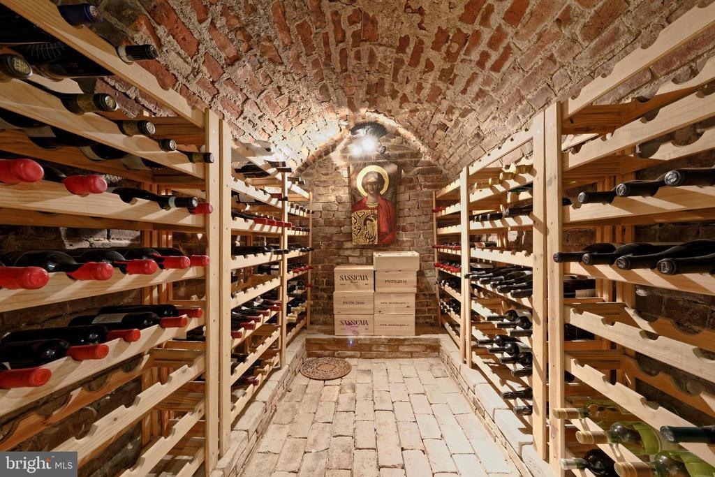All brick wine storage with glass door entrance - 711 PRINCE ST, ALEXANDRIA