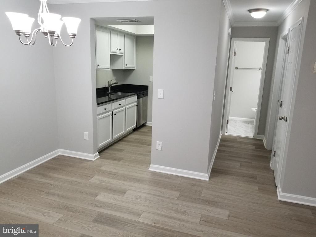 Dining/Living Room.1 - Kitchen and Hallway - 14905 RYDELL RD #204, CENTREVILLE