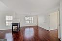 Sitting area divided from bedroom by fireplace - 1306 MONROE ST, HERNDON
