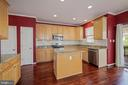 Close up shows granite counters and pantry door - 1306 MONROE ST, HERNDON
