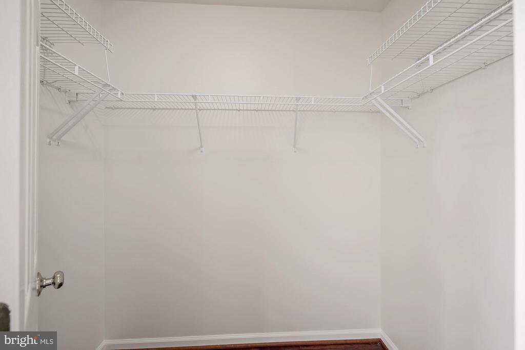 Walk in closet in primary bedroom - 1306 MONROE ST, HERNDON