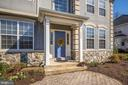 Paver front walkway and welcoming portico - 1306 MONROE ST, HERNDON