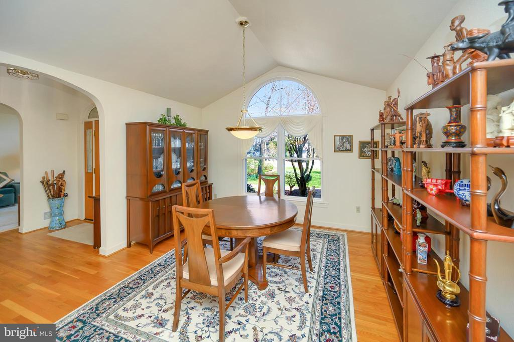 Formal dining room with cathedral ceilings - 112 WOODLAWN TRL, LOCUST GROVE
