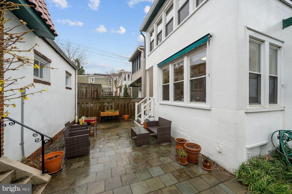Private patio in fenced rear yard - 3249 38TH ST NW, WASHINGTON