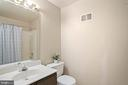 Another full bath is in the lower level! - 10525 ELMENDEN CT, OAKTON