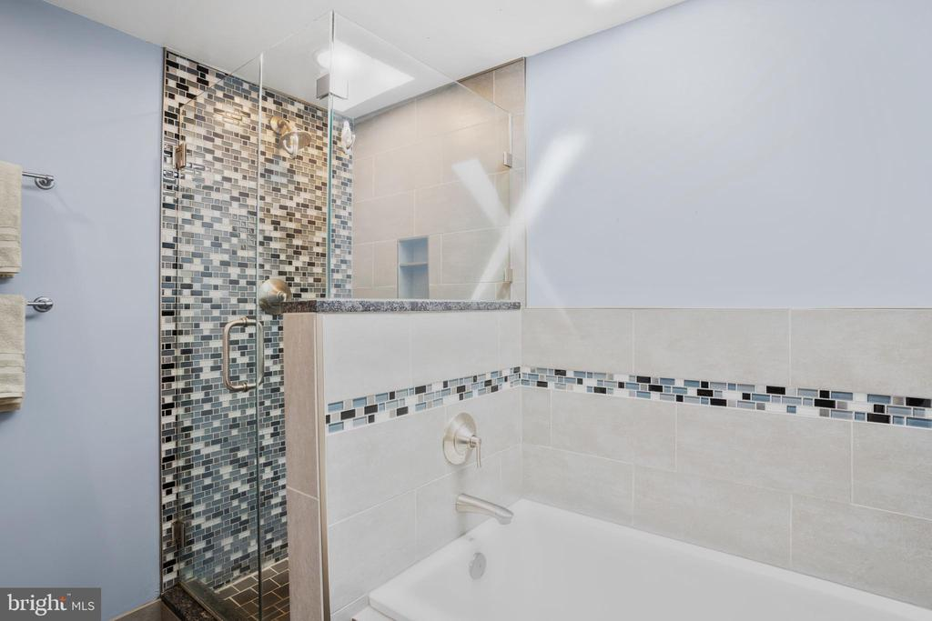 ...with dual sinks, soaking tub, and tiled shower. - 10525 ELMENDEN CT, OAKTON