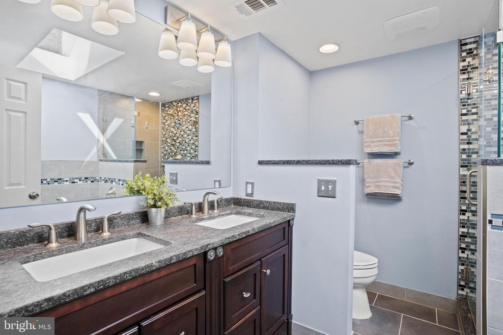 Attached stunningly renovated primary bath... - 10525 ELMENDEN CT, OAKTON