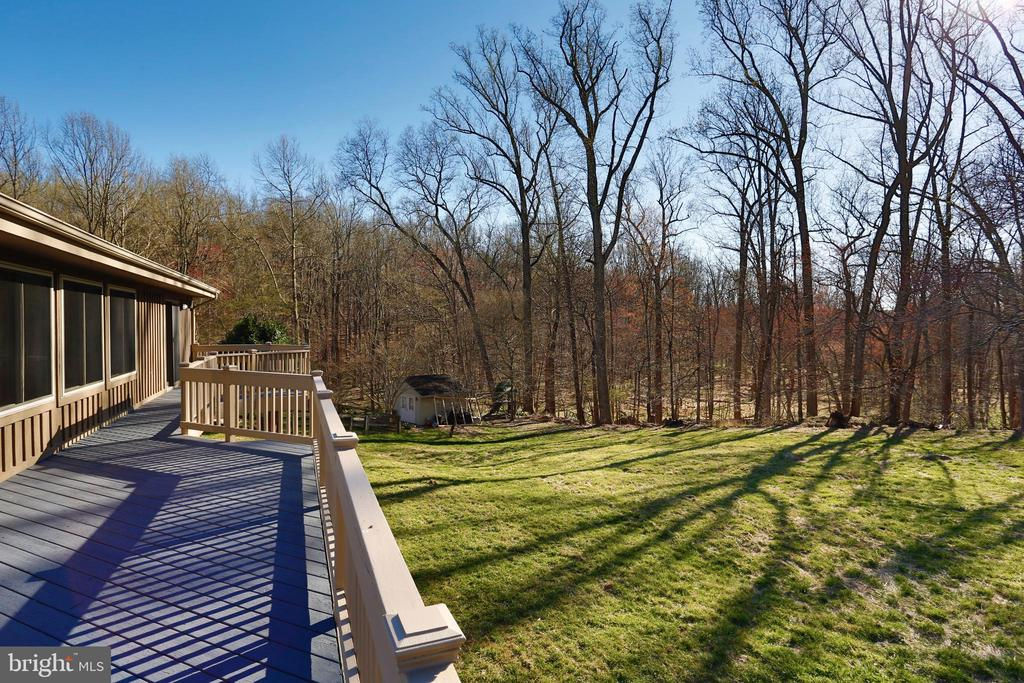 View of huge back yard from deck - 14908 TALKING ROCK CT, NORTH POTOMAC