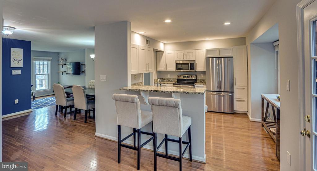Family Room to kitchen, dining and living rooms - 11811 GREAT OWL CIR, RESTON