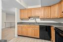 Kitchen w granite, new floor and new appliances - 6350 FENESTRA CT #129A, BURKE