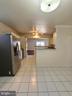 Kitchen with bar countertop - 14352 SAGUARO PL, CENTREVILLE