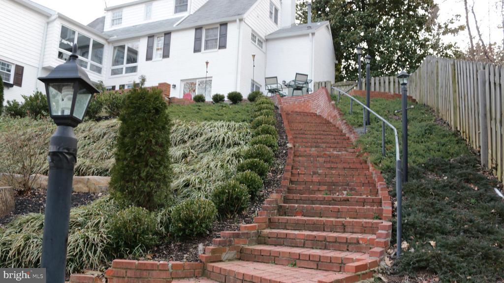 Stairs from patio to pool - 8703 SUDBURY PL, ALEXANDRIA