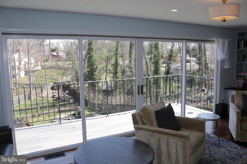 Sliding glass doors to balcony over looking pool - 8703 SUDBURY PL, ALEXANDRIA