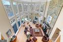 Floor-to-ceiling windows with sweeping river views - 658 LIVE OAK DR, MCLEAN