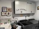 Main level laundry / mud room off garage - 105 JEFFERSON AVE, LOCUST GROVE