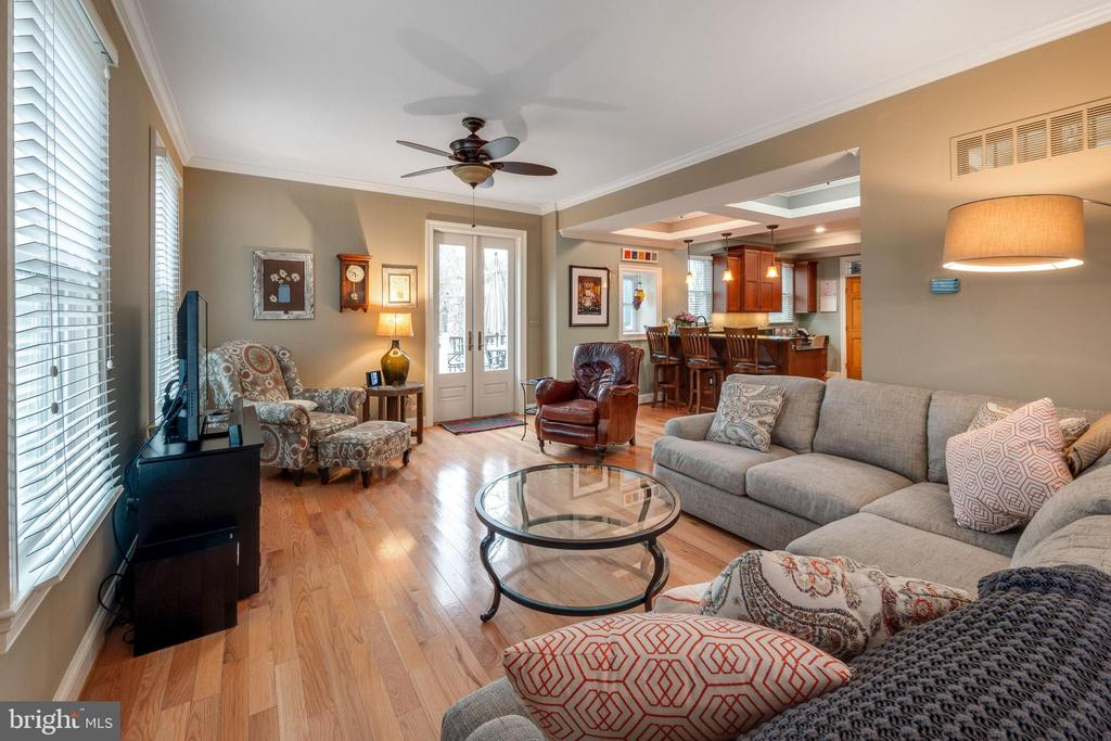 Large family room with door to rear deck - 1244 MONROE ST NE, WASHINGTON