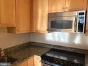 Updated kitchen with stainless steel appliances - 1020 N HIGHLAND ST #223, ARLINGTON