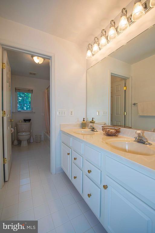 Hallway Bathroom with double vanity - 11413 RAMSBURG CT, NORTH POTOMAC