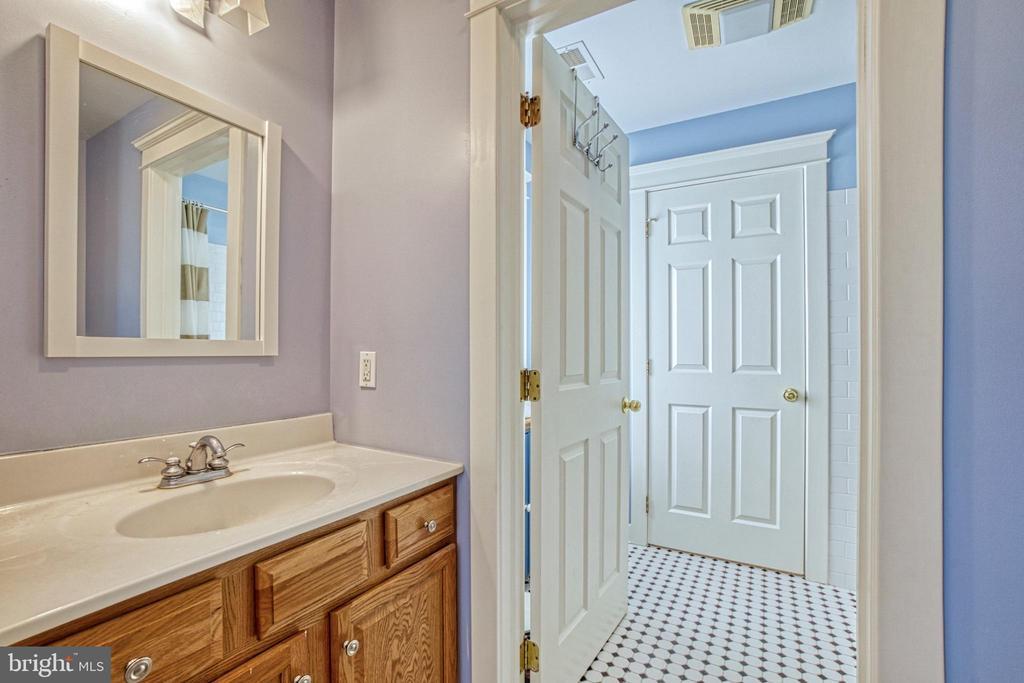 Jack-n-Jill bathroom. Powder room for BR #2. - 6519 ELMHIRST DR, FALLS CHURCH