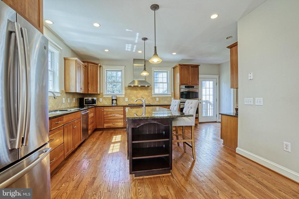 Cherry cabinets. Granite tops. Island w/sink. - 6519 ELMHIRST DR, FALLS CHURCH