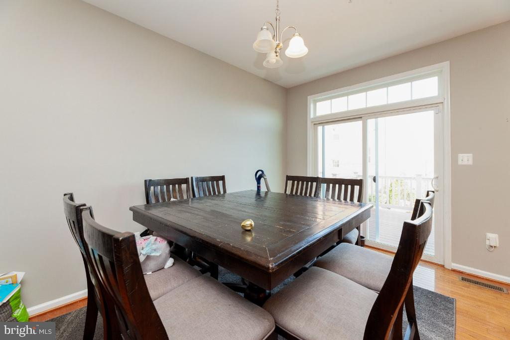 Dining area comfortably seats 8 (or more!) - 702 WAVELAND AVE, CAPITOL HEIGHTS