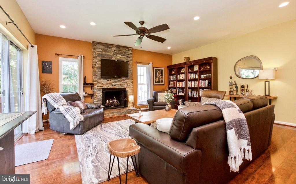 Large Living Room area with cozy fireplace! - 20693 LONGBANK CT, STERLING