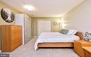 Downstairs bedroom suite with plenty of storage! - 20693 LONGBANK CT, STERLING
