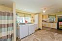 Huge laundry room/mud room with shower - 35951 ASHBY FARM CIR, HILLSBORO