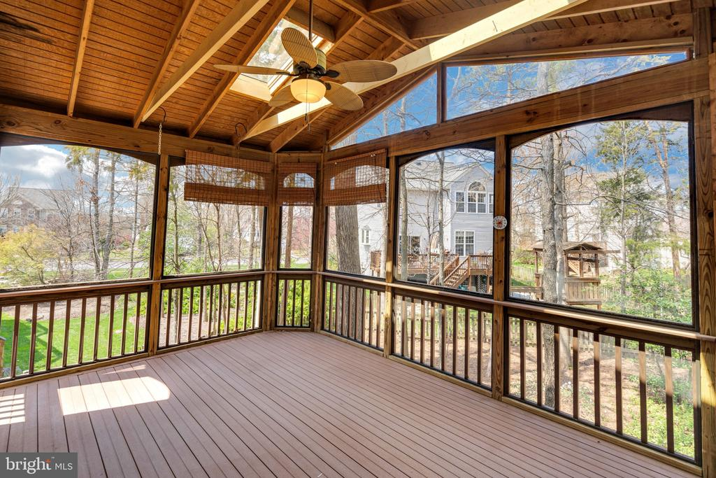 Screened in porch over looks trees in yard - 43446 RANDFIELD LN, CHANTILLY
