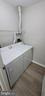 Laundry Room - Replaced dryer exhaust vent to top - 14905 RYDELL RD #204, CENTREVILLE