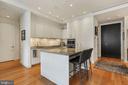 Kitchen features large breakfast island - 1177 22ND ST NW #4G, WASHINGTON