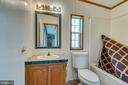 Hall bath features single bowl vanity, tub/shower - 53 CAMP HILL LN, HARPERS FERRY