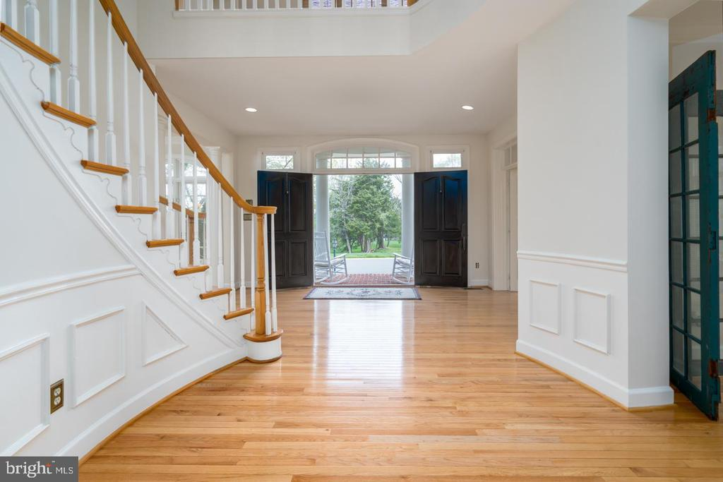VIEW INTO THE FOYER FROM THE FAMILY ROOM - 23002 LOIS LN, BRAMBLETON