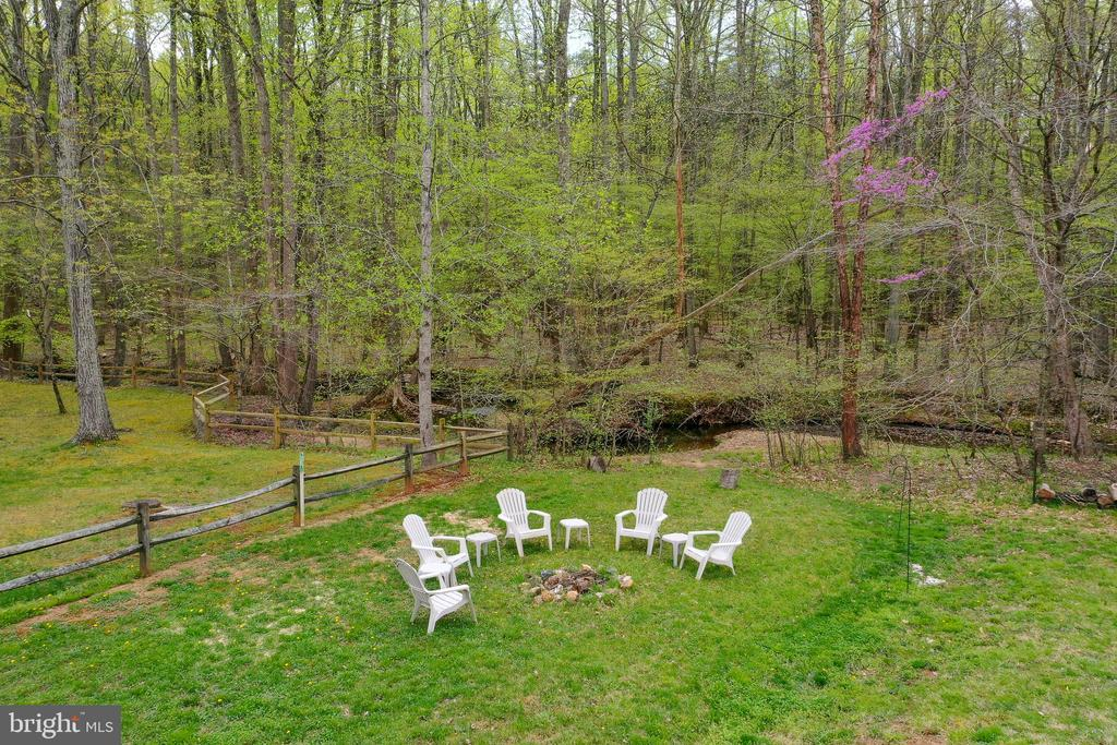 There is a stream just beyond the fire pit. - 54 CHRISTOPHER WAY, STAFFORD