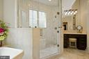 Seamless Glass and Marble Shower in Owner's Bath - 22608 CREIGHTON FARMS DR, LEESBURG