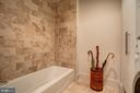 Shower and Tub Combination. In Unit Laundry - 1615 N QUEEN ST #M303, ARLINGTON