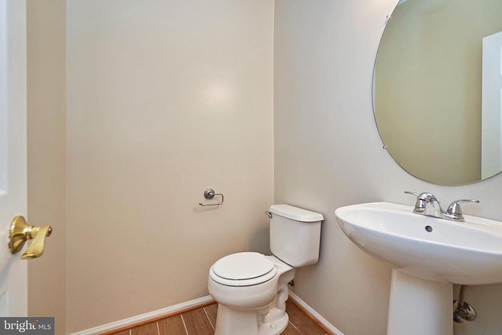 Powder room with new porcelain floor - 11436 ABNER AVE, FAIRFAX