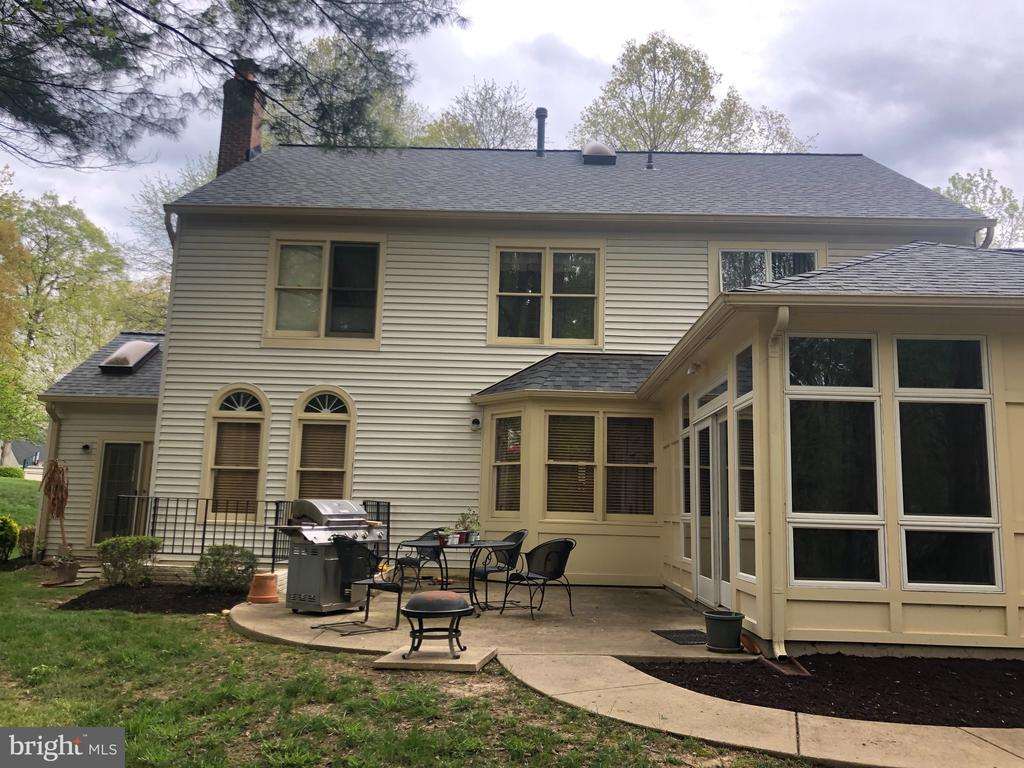 Rear view with patio - 6166 POHICK STATION DR, FAIRFAX STATION